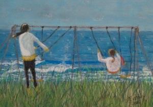 Girls swinging at Seaside Oregon